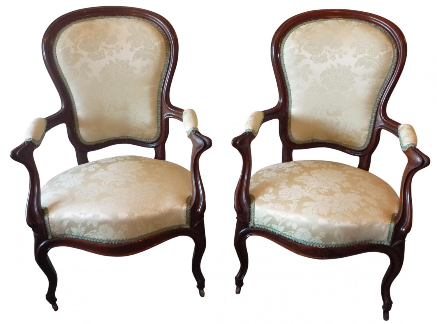 A pair of French rosewood arm chairs c 1865