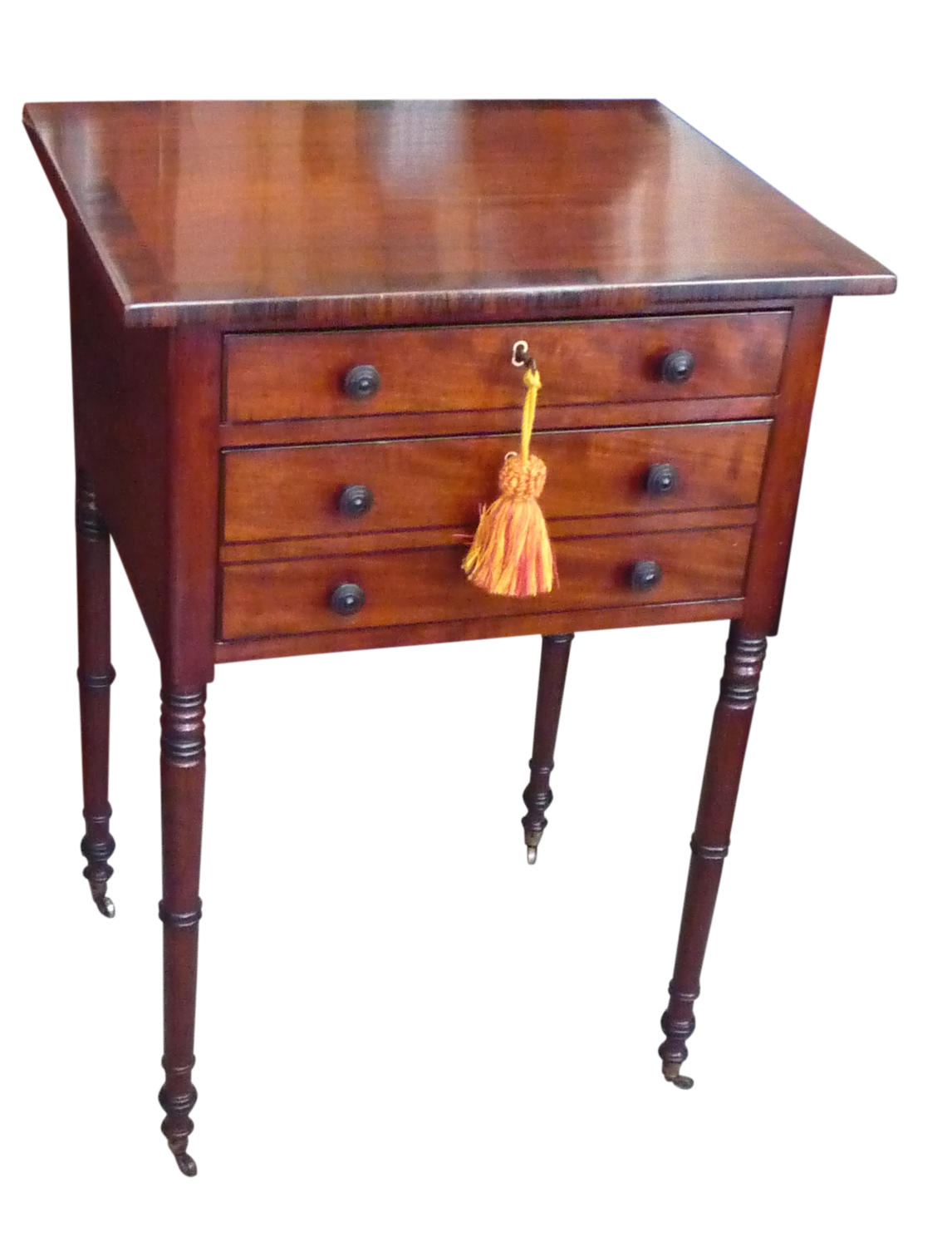 An attractive Regency mahogany work table