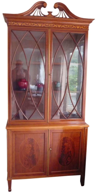 A fine Edwardian inlaid mahogany bookcase.
