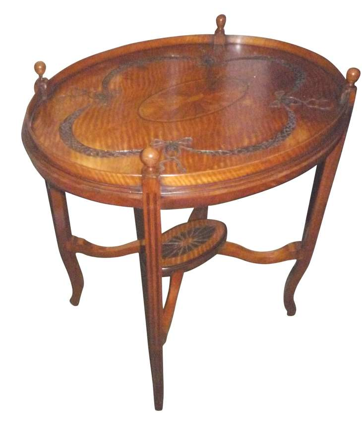A Victorian carved and inlaid oval satinwood table circa 1890