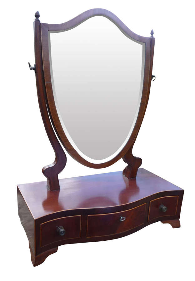 An inlaid mahogany serpentine front antique toilet mirror.