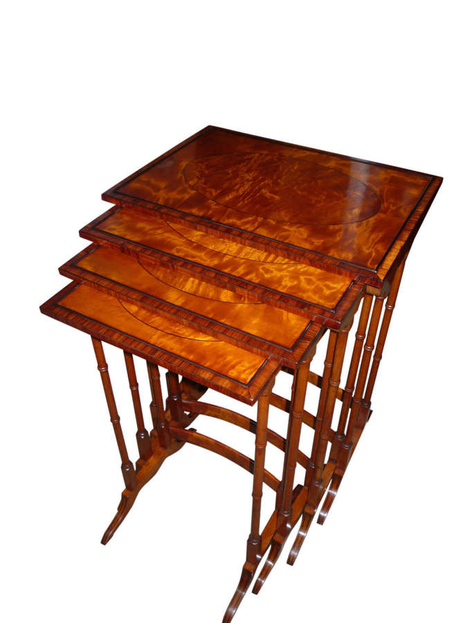 A fine inlaid satinwood nest of tables circa 1895
